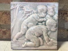 """Multiple tiles were available from this """"design set."""". lighty incised encircled signature pressed onto the backside of the tile. in 1890, George W. Robertson, a chemist and glaze expert for Low, established Robertson Art Tile in Morrisville, Pennsylvania.   eBay!"""