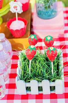 Amazing cake pops at a strawberry picnic birthday party!  See more party planning ideas at CatchMyParty.com!