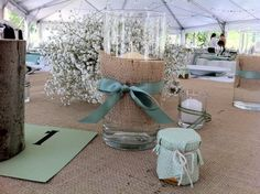 I love the idea of using burlap with baby's breath, queen anne's lace, and some pastel flowers!