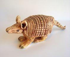 Armadillo pinch pot. Great textures. Site has more outstanding student examples.