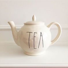 Unique Tea Pot designed by San Francisco Bay area artist Rae Dunn. Built entirely by hand from high quality white stoneware clay. Rae's inspiration comes from the earth and finds beauty in simple shap
