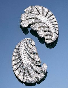 A pair of diamond clip brooches, circa each designed as a scrolling feather set throughout with old brilliant-cut diamonds, with a central baguette-cut diamond spine, diamonds approximately carats total, length Bijoux Art Deco, Art Deco Jewelry, I Love Jewelry, Vintage Jewelry, Fine Jewelry, Harlem Renaissance, Gemstone Jewelry, Diamond Jewelry, Diamond Are A Girls Best Friend
