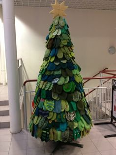 A creative display for a donation drive at your church. Tree is completely made with donated mittens. On display in Rosendal, Kvinnherad, Norway until December, the mittens have since been sent to the Ukraine for the poor and homeless. Noel Christmas, Christmas Crafts, Christmas Decorations, Holiday Decor, Christmas Greetings, Recycled Christmas Tree, Tree Decorations, Kwanzaa, Alternative Christmas Tree