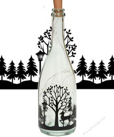 Deer in Forest Christmas Scene Wine bottle Vinyl Quote by Tina Fallon Vinyl Quote comes with commercial use permission when cut from… House Silhouette, Deer Silhouette, Wine Bottle Crafts, Wine Bottles, Vinyl Quotes, Vinyl Decor, Vinyl Paper, Bottle Lights, Christmas Projects