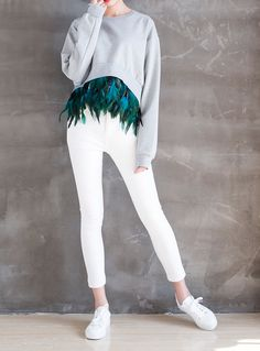 This is our new season favorite. Casual fit. Light grey sweater with feather hem trim. The feather hem is removable. Get it at pellobello.com now!