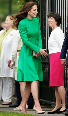MAY 23, 2016  Kate Middleton wowed at the Chelsea Flower Show in an emerald green dress with a matching wide belt at the waist. She accessorized her ensemble with nude leather heels and her signature delicate jewelry.