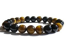 """Available now on Amazon.com  #ZENstore Tiger Eye and Black Tourmaline Bracelet with Certified Gemstones, Size: 7""""(M), Gift Box ZENstore http://www.amazon.com/dp/B00MW0O1C4/ref=cm_sw_r_pi_dp_Pz36ub1R2TYQV"""