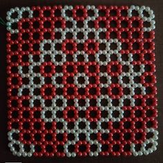 Mat made of moti. Size : Can be customized Can be used as: As a mat in Deoghar As a basement for flowerpot As a just design on the table/ showcase. Cross Stitch Flowers, Cross Stitch Patterns, Mandir Decoration, Beard Jewelry, Crochet Bedspread Pattern, Diy Crafts Hacks, Beaded Brooch, Beaded Bags, Brick Stitch