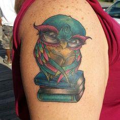 Thomas graham super genius tattoo seattle wa black and for Blue horseshoe tattoo