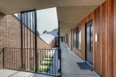 Bakers Architecten BNA BV (Project) - Droo-Zuid fase 2 Modern Courtyard, Adaptive Reuse, Montego Bay, Corridor, Arcade, Balcony, Entrance, Stairs, Loft