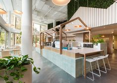 Dining booths within this Melbourne restaurant are housed beneath individual pitched roofs, designed by local practice Biasol Design Studio