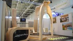 Curved timber exhibition stand architecture.