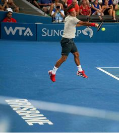 Roger Federer - Brisbane Roger forehand in the air.
