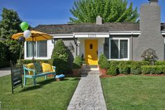 Gray and White exterior, Yellow front door.  Turquoise accents