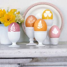 fun Easter eggs with leaf prints, displayed in egg cups....I could really get into collecting egg cups!  Like I need to collect something else ` lol