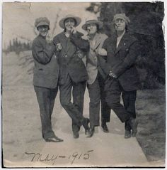 Women wearing Suits Hats and Smoking Cigars 1915