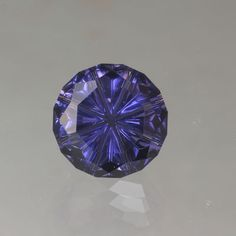 Iolite gemstone 5.52 carat.  Starbright cut by John Dyer