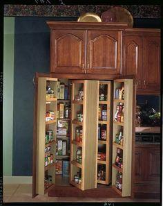 Merillat classic tolani in oak kona merillat cabinetry for Kraftmaid closet systems