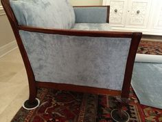 Reupholstering a wood trimmed antique sofa like ours