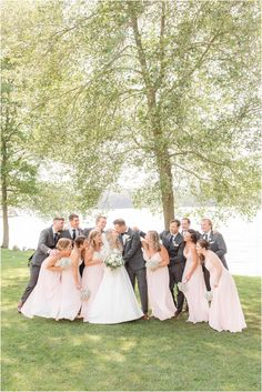 newlyweds kiss with wedding party around them at Indian Trail Club | Classic summer wedding day at Indian Trail Club in Franklin Lakes, NJ photographed by New Jersey wedding photographer Idalia Photography. See more inspiration here for a summer wedding day! #IdaliaPhotography #IndianTrailClubWedding #NJWedding #SummerWeddingIdeas