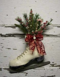 Decorated ice skates .... Found ice skates at goodwill for cheap...