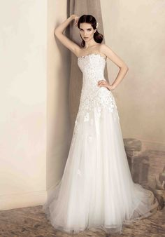 """The A-Line wedding dress features a skirt that gradually begins to flare out from a fitted bodice, starting below the natural waist, and lightly skimming the hips, as it and extends to the hem, forming an """"A"""" shape."""