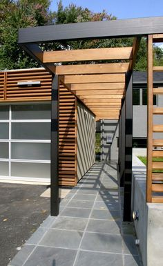 Prefer modern to romantic? Consider a pergola with clean strong lines and contrasting textures.
