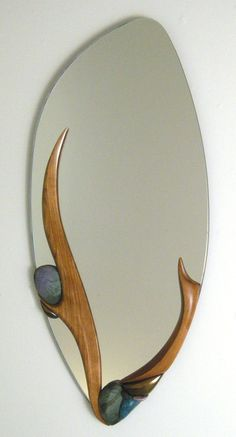 Precious Stone by Jan Jacque (Ceramic & Wood Mirror) Artful Home is part of Wood mirror - Precious Stone by Jan Jacque Graceful plumes of sculpted cherry wood and colorful, pitfired clay Rustic Mirrors, Wood Mirror, Mirror Art, Ceramic Wall Art, Wood Wall Art, Vitrier Paris, Mirror Inspiration, Fire Clay, Wood Projects