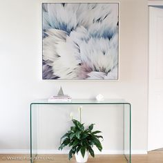 I love a simple entryway with a stunning piece of statement art. What do you think? #whitefoxstyling