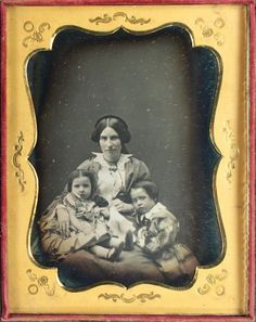 http://www.ebay.com/itm/Clean-Half-Plate-Family-Daguerreotype-of-Mother-with-Her-Timid-Children-CASED-/263115801304?hash=item3d42ec82d8:g:WNAAAOSwYyVZeShz