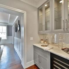 Gray Butler Pantry Cabinets with Stainless Steel Mini Brick Tiles