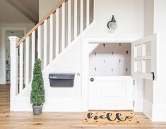 This under the stairs is always a favourite for all visitors both big and small. It comes fully equipped with a play kitchen and a reading nook. The dutch door is kid favourite too! Under Basement Stairs, Under Stairs Dog House, Door Under Stairs, Under Stairs Playhouse, Finished Basement Playroom, Kid Playhouse, Basement Layout, Basement Walls, Porte Diy