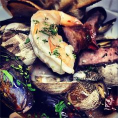 Madeleine's cafe, Seafood Hot Pot, fresh clams, mussels, gulf shrimp, & house made sausage, in the Josper Oven
