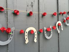 derby theme garland horseshoes & roses | paper horseshoes | derby backdrop party banner |oaks race racing | ky derby | derby kentucky mantel by thekindpilot on Etsy https://www.etsy.com/listing/274986522/derby-theme-garland-horseshoes-roses