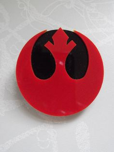 Rebel Alliance Red and Black Double Layer Laser Cut Acrylic Brooch. £6.50, via Etsy.