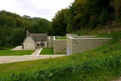 Green house, stone walls and multi-level  gardens, sod roof, underground garage