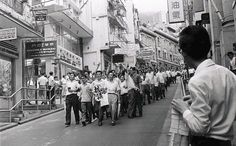 Demonstrators marching to Central pass through Wyndham Street on May 22, 1967, during the 1967 riots in Hong Kong. Photo: SCMP Pictures