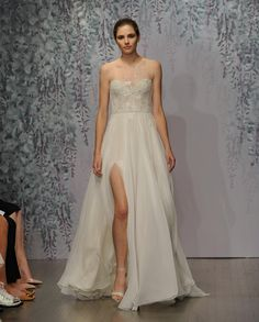 My thought watching the video... I wonder what these gowns would look like on actual people? These models are so flat, they remind me of cardboard dolls... and I just can't imagine a real person wearing these designs. Monique Lhuillier's Fall 2016 Wedding Dress Collection Channels a Romantic Garden | TheKnot.com
