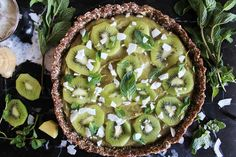 raw vegan cashew fruit tart with coconut, ginger + mint