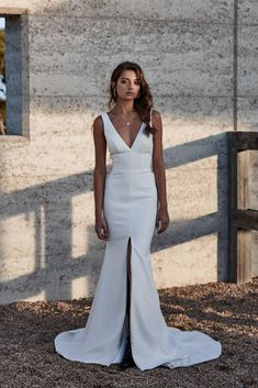 Clara wedding dress | One Day Bridal | CHOSEN – New Reign Collection 2018 | A streamlined wedding gown with v-neck and back with a statemen split.
