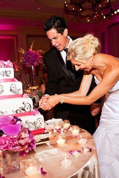 Bride and groom having fun during the cake-cutting at their island destination wedding at the Ritz-Carlton, Puerto Rico  #weddingcake #weddingreception #brideandgroom #weddingphotographerpuertorico #bestweddingphotographers