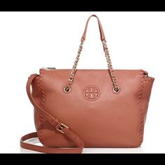 """Tory Burch Marion Leather Satchel Tory Burch Marion leather satchel.  Brand new with tags.  Beautiful and unique maple sugar color.  Pebbled leather.  This color is only sold on TB Europe.  Whipstitched leather shoulder bag with emblem detail.  Dual carry handles, 6"""" drop.  Removable adjustable leather shoulder strap, 23.25"""" drop.  Top zip closure.  Goldstone hardware.  One inside zip pocket.  Fully lined. Tory Burch Bags Satchels"""