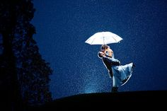 I took this in May of 2011 at one of the most fun weddings I've ever shot. I lit the couple from behind with a single Canon speedlight aiming to bounce the light off the umbrella and illuminate the couple and the rain. It was POURING like it never does in Victoria, so I had my light in a ziploc baggy to protect it.  Copyright: Jon-Mark Wiltshire Jon-Mark Photography jonmarkphoto.com Victoria, BC, Canada