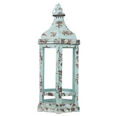 Give your home a subtle, natural glow with this unique Antique Turquoise Hexagonal Metal & Glass Lantern! This fun lantern features an eye-catching hexagonal shape, rusty and textured turquoise metal, clear glass windows, and a swing-latch opening top. Just insert the candle of your choice for instant ambiance, decorate the interior with flowers or other embellishments for a personalized touch, or leave it empty for a minimalist approach!        Item will be hot when ...