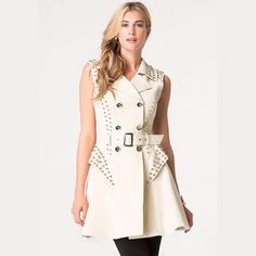 """new   Bebe Bone Ivory Teva Studded Rocker Trench Rockstar-worthy poplin trench vest detailed by gleaming oversized studs and flawless topstitching. Side peplum accents & curve-defining shaping seams for a flattering fit. Double-breasted style & D-ring belt buckle keep the look polished. Back hem vent. Front buttons. Fully lined.   • XS • 35"""" bust   27"""" waist   33"""" length  • color: bone (has slightly more of a yellow undertone in person than pictured) • 50% Cotton, 45% nylon, 5% elastane…"""