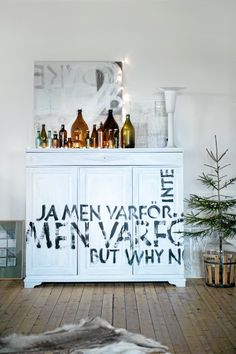 I like the cabinet...would be a fun, graphic bar  (Scandinavian Chic House With Rustic And Vintage Features | DigsDigs)