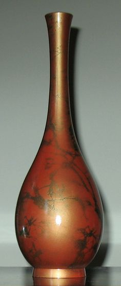 long-necked mottled bronze/pewter flower vase
