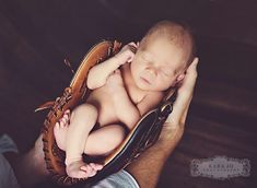 how precious--dad holding baby in baseball glove