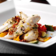 Baked red gurnard with roasted vegetables  Serves: 4 Preparation time: 20 minutes Cooking time: 15 minutes  You will need 575g fillets ½ red onion, finely chopped 1 clove garlic, crushed 3  tablespoons olive oil 55g dried breadcrumbs 30g sun blush tomatoes, chopped 1 tablespoon fresh chopped thyme Salt and black pepper 1 red pepper, deseeded and roughly chopped 1 yellow pepper, deseeded and roughly chopped 1 courgette, trimmed and roughly chopped