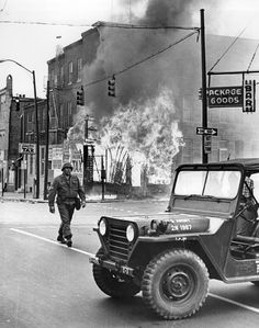A National Guardsman can do little as a shop burns out of control amid the 1968 riots. Insurers estimated damage in Baltimore at $8 million to $10 million during the unrest. The immediate cause of the rioting was the assassination of Dr. Martin Luther King, Jr. on April 4.  Photo credit: William H. Mortimer / Baltimore Sun